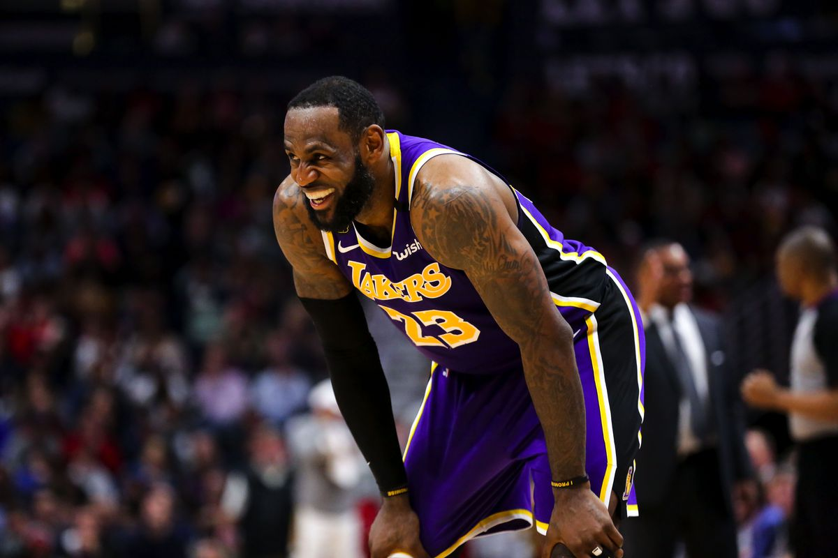 Los Angeles Lakers forward LeBron James smiles during the fourth quarter against the New Orleans Pelicans at the Smoothie King Center.