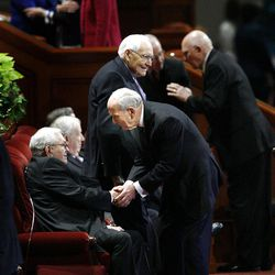 President of the Quorum of the Twelve Apostles Elder Boyd K. Packer, seated,  is greeted by Elder Russell M. Nelson before the morning session of the182nd Semiannual General Conference for The Church of Jesus Christ of Latter-day Saints in the Conference Center in Salt Lake City on Saturday, Oct. 6, 2012.
