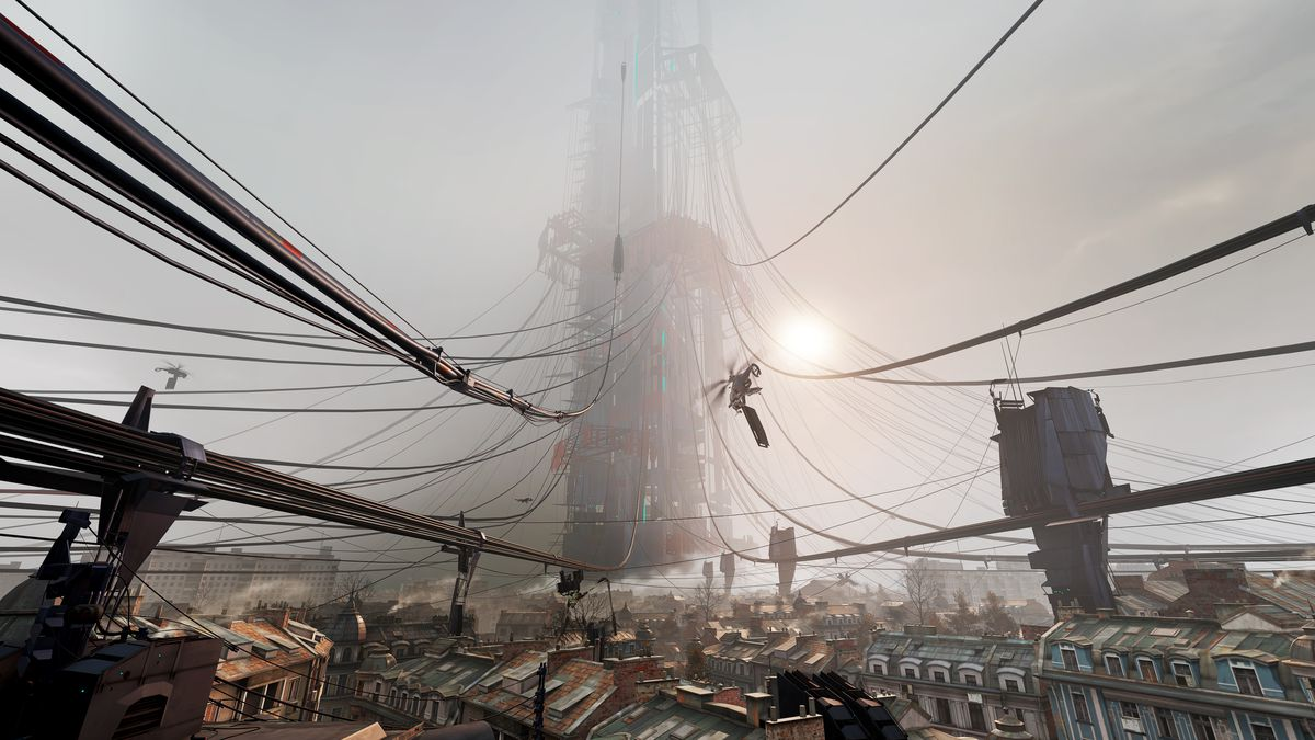 misty view over a city with a futuristic tower in the distance connected my cables
