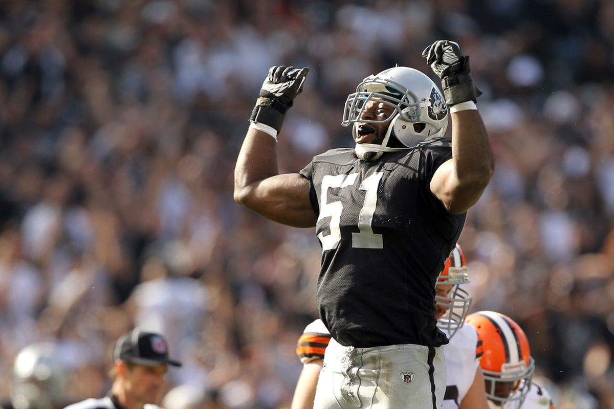Aaron Curry celebrates a fumble recovery against Cleveland.
