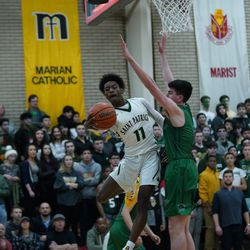 St, Patrick's Justin Walker (11)  dishes a pass Friday 02-08-19. Worsom Robinson/For the Sun-Times.