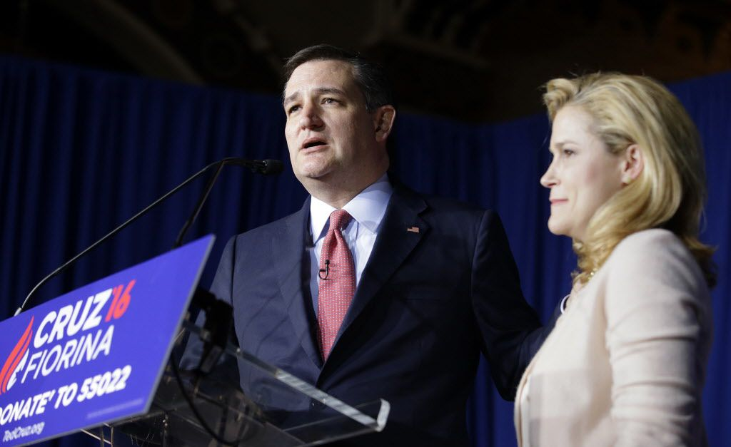 Republican presidential candidate Sen. Ted Cruz, R-Texas, speaks Tuesday night with his wife, Heidi, by his side at a primary night campaign event in Indianapolis.   Darron Cummings/AP