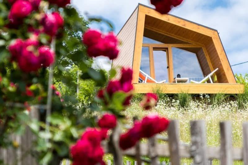 Angular wooden cabin on hill