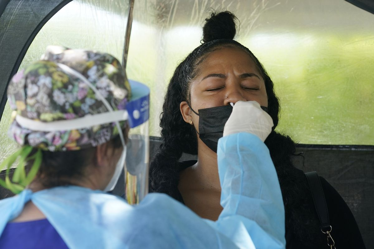 A woman is tested for COVID-19 in Miami.