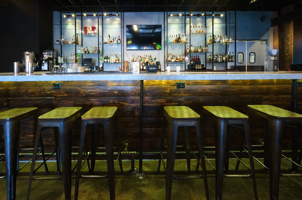 A bar with stools