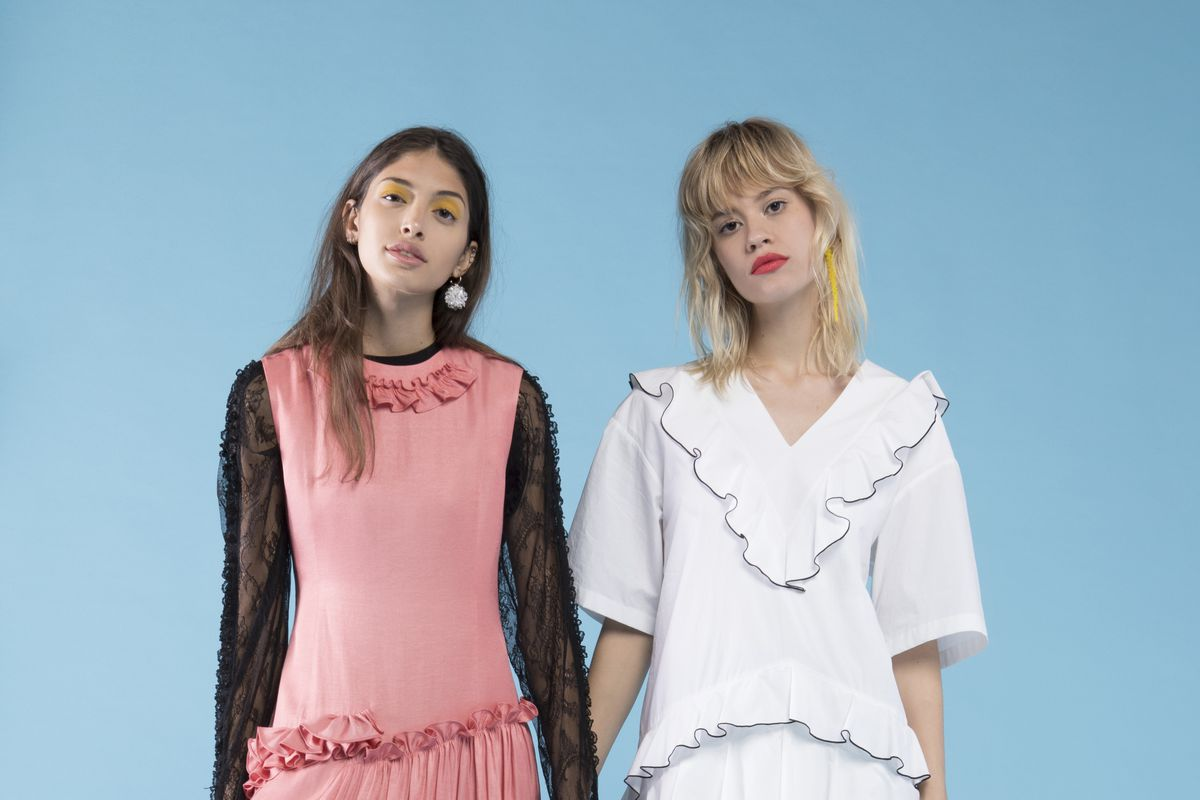 Two models in ruffled dresses