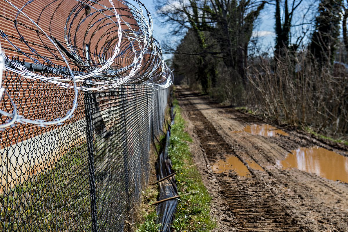 Razor wire runs along a section of the under-construction Westside Trail.