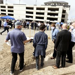 Provo Mayor Michelle Kaufusi speaks with others before breaking ground at the 85 North Apartments in Provo on Thursday, March 18, 2021. The seven-story, 74-unit building aims to address the shortage of affordable units for senior citizens, the disabled and adults with autism.