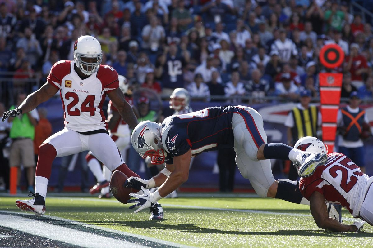 Adrian Wilson defends as Rob Gronkowski misses a pass in Week 2 last year.