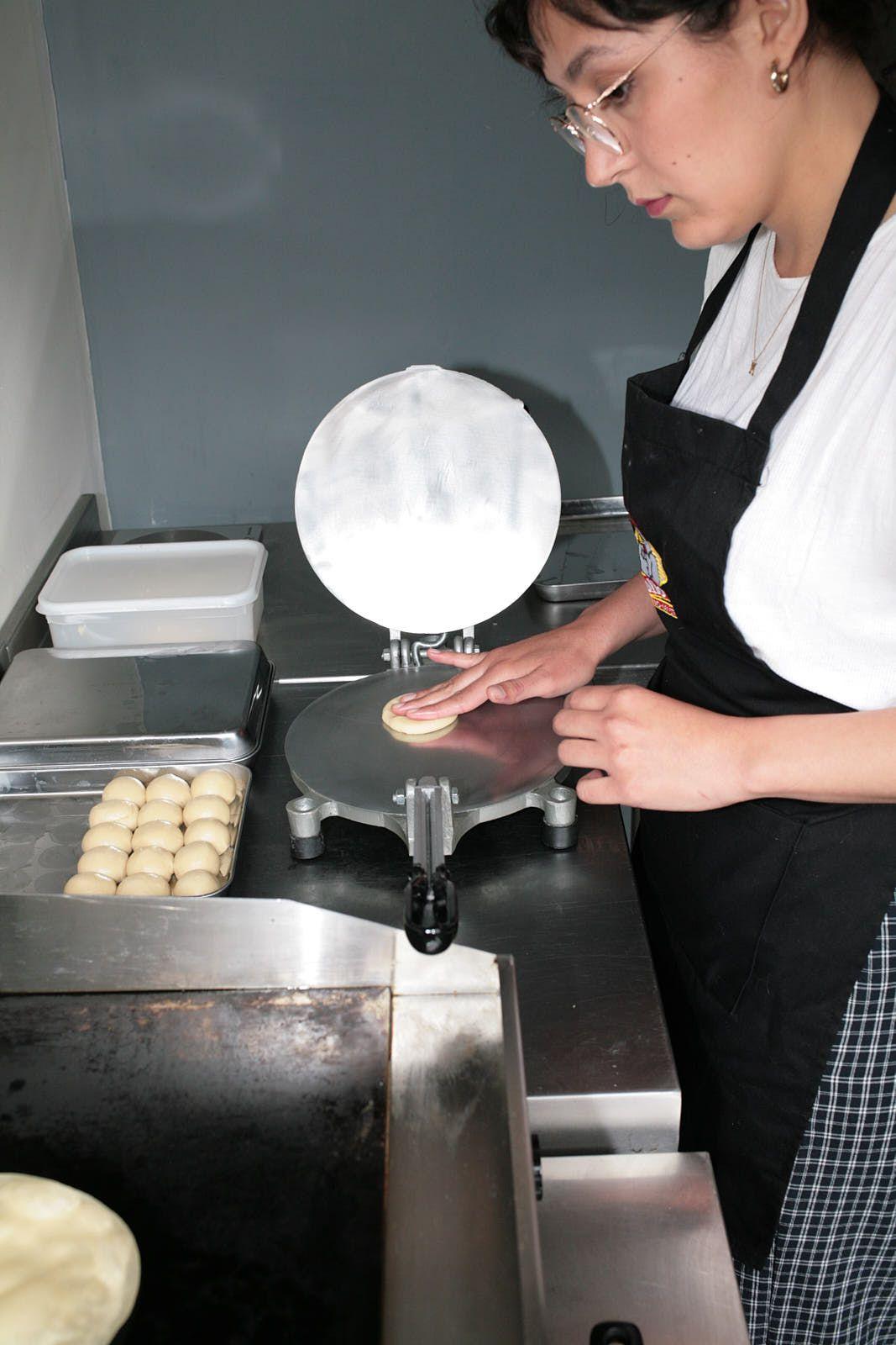 Chef Michelle Salazar making tortillas at Pollo Feliz in Netil Market this summer