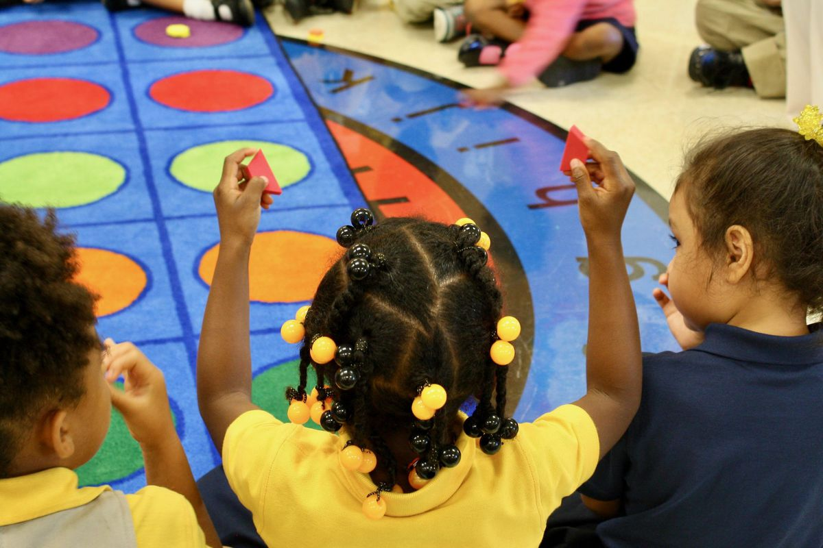 The students learn to identify shapes and compare and contrast them by size, number of sides and color.
