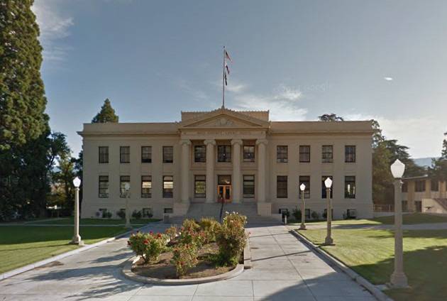 The exterior of Inyo County Courthouse. The facade is white with columns near the entrance.