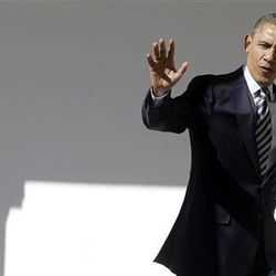 President Barack Obama waves as he walks down the West Wing Colonnade of the White House in Washington, Tuesday, Feb. 12, 2013, ahead of tonight's State of the Union speech on Capitol Hill.