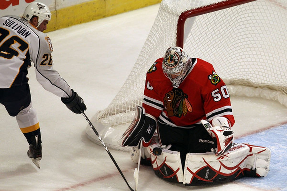 Corey Crawford of the Chicago Blackhawks stops a shot by Steve Sullivan of the Nashville Predators at the United Center on October 13 2010 in Chicago Illinois. (Photo by Jonathan Daniel/Getty Images)