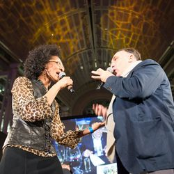 Hosts Carla Hall and Jose Andres banter.