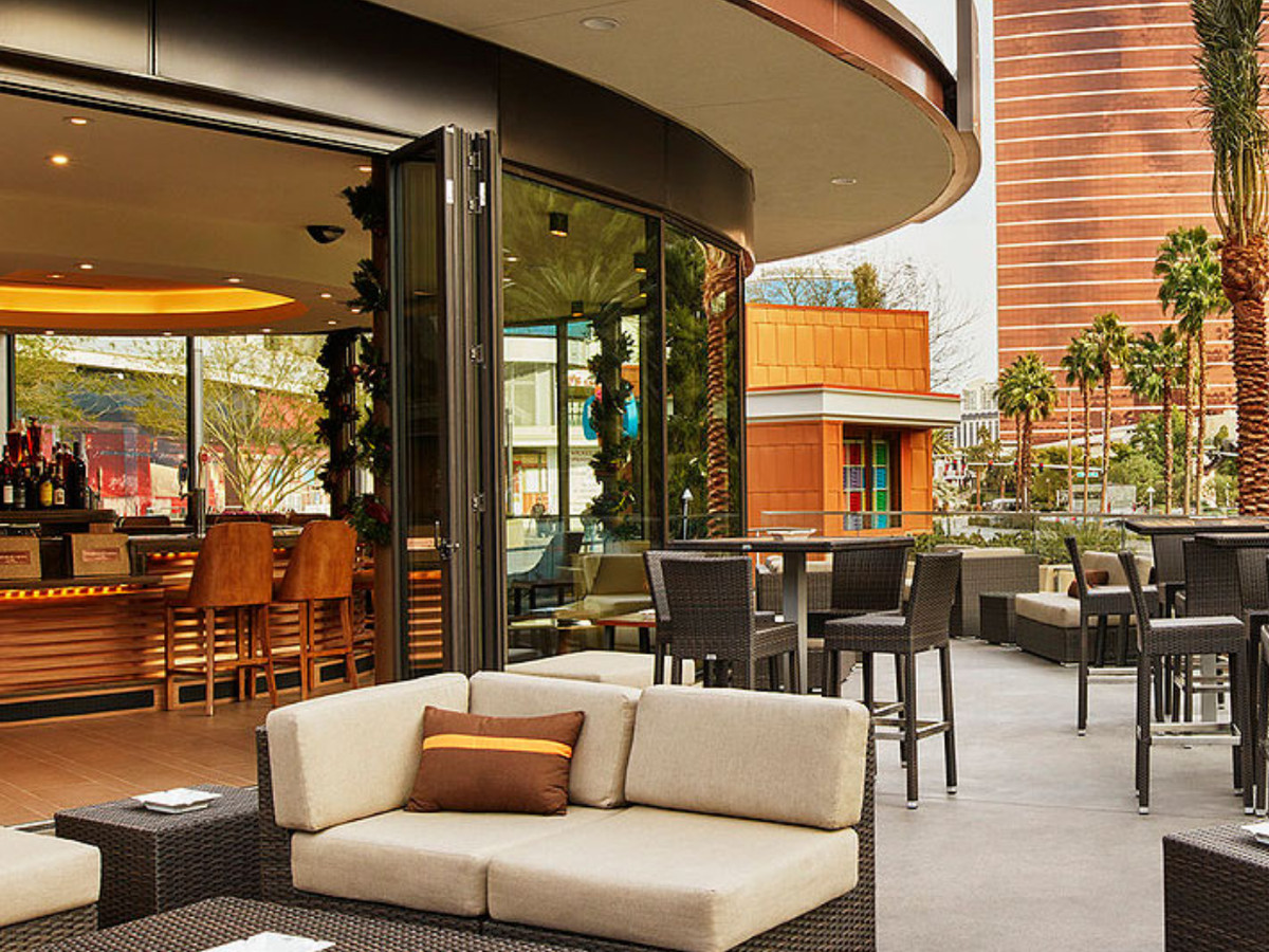 A handsome patio next to a rounded bar