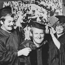BYU head football coach LaVell Edwards with daughter Ann and her husband Ken Cannon as he receives a doctoral degree at BYU Aug. 14, 1978.