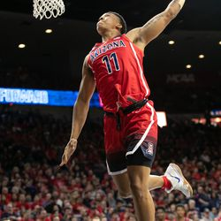 Ira Lee (11) does a leaning slam during the 2018 Red-Blue dunk contest in McKale Center on October 14 in Tucson, Ariz.