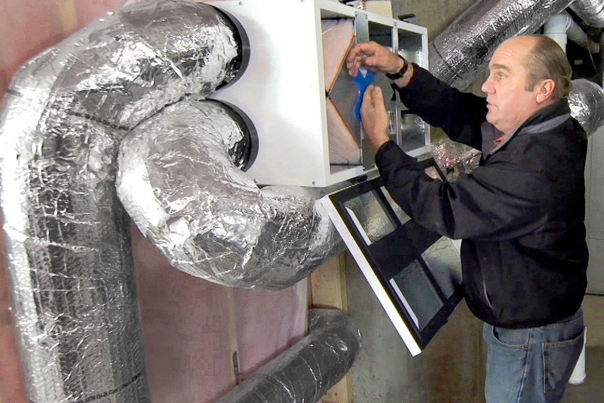 Man Works On ERV System