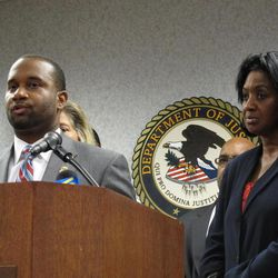 U.S. Attorney Edward Stanton speaks at a news conference as Frances Wright, right, the widow of a murdered code enforcement officer, listens on Tuesday, July 5, 2011 in Memphis, Tenn. Stanton took questions from reporters after Memphis gun dealer Dale Mardis was sentenced to life in prison for killing Mickey Wright in 2001.