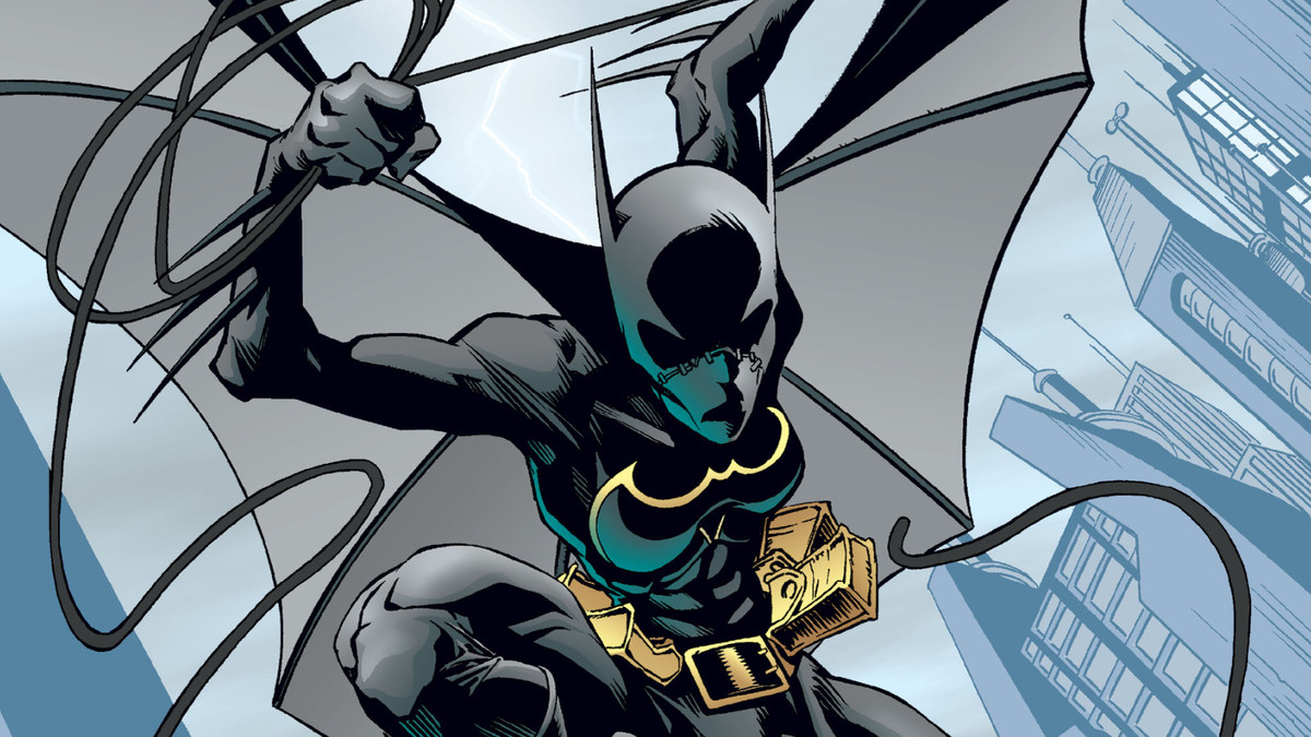 Cassandra Cain as Batgirl in her classic all black costume with a yellow bat outline on her chest and a mask that fully covers her entire face, on the cover of Batgirl #1, DC Comics (2000).