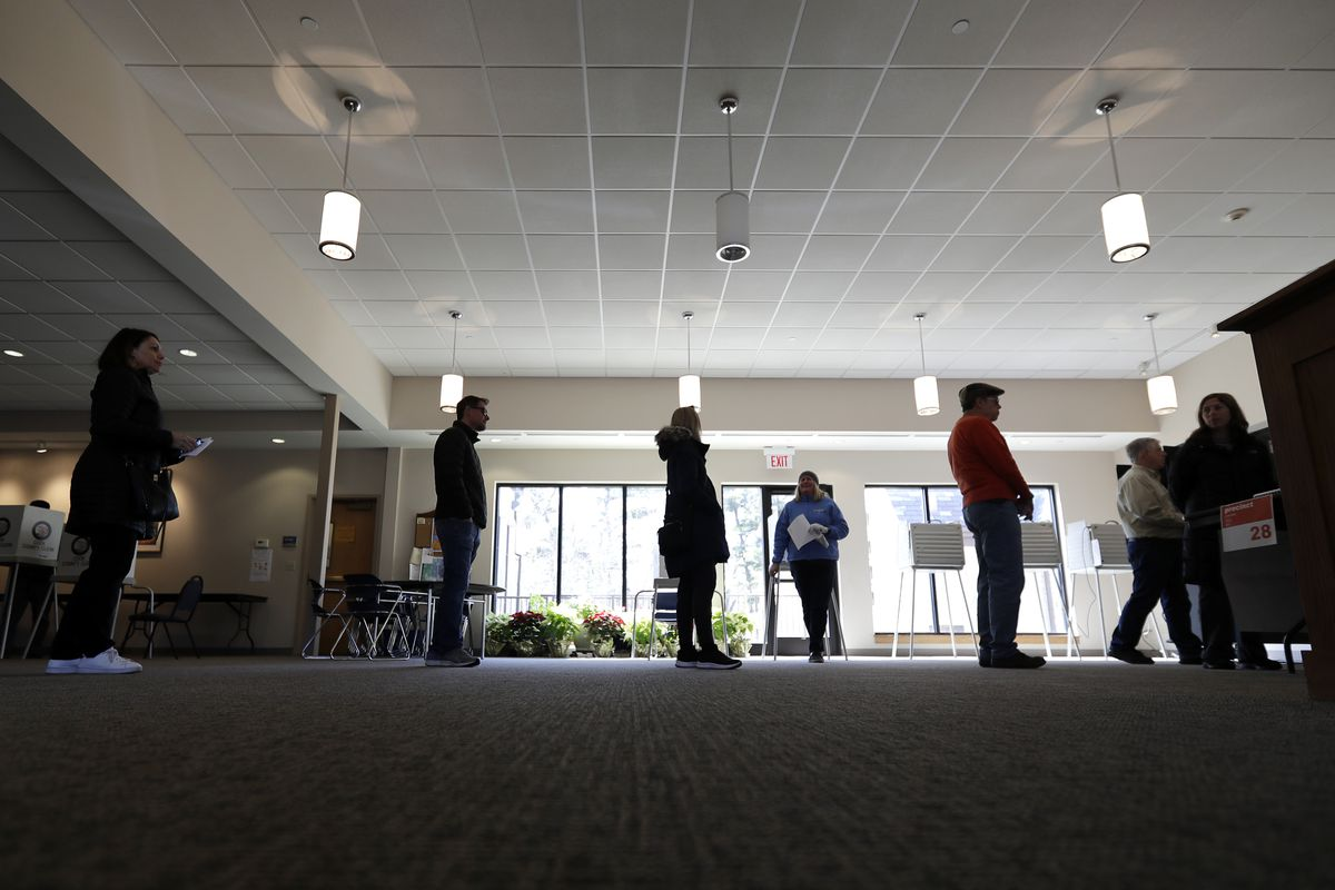 Observing social distancing guidelines, Evanston residents line up to vote on Tuesday, March 17, 2020.