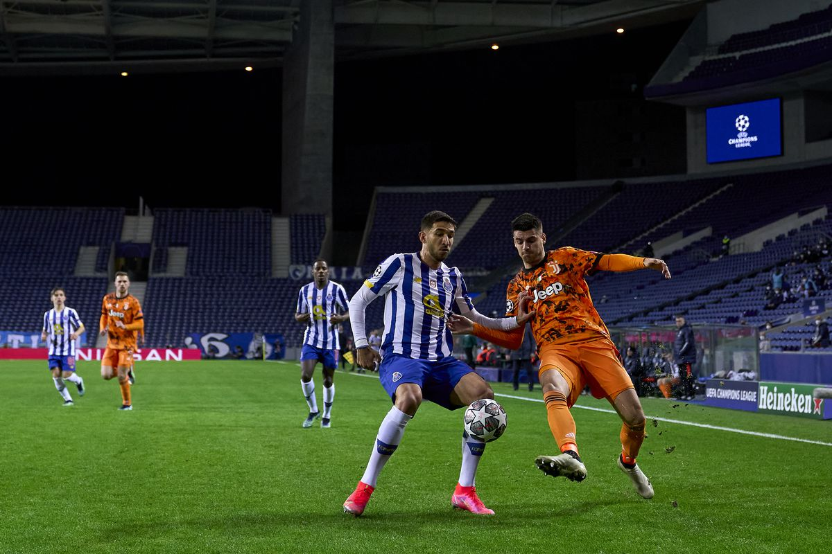 Marko Grujic of FC Porto competes for the ball with Alvaro Morata of Juventus during the UEFA Champions League Round of 16 match between FC Porto and Juventus at Estadio do Dragao on February 17, 2021 in Porto, Portugal.