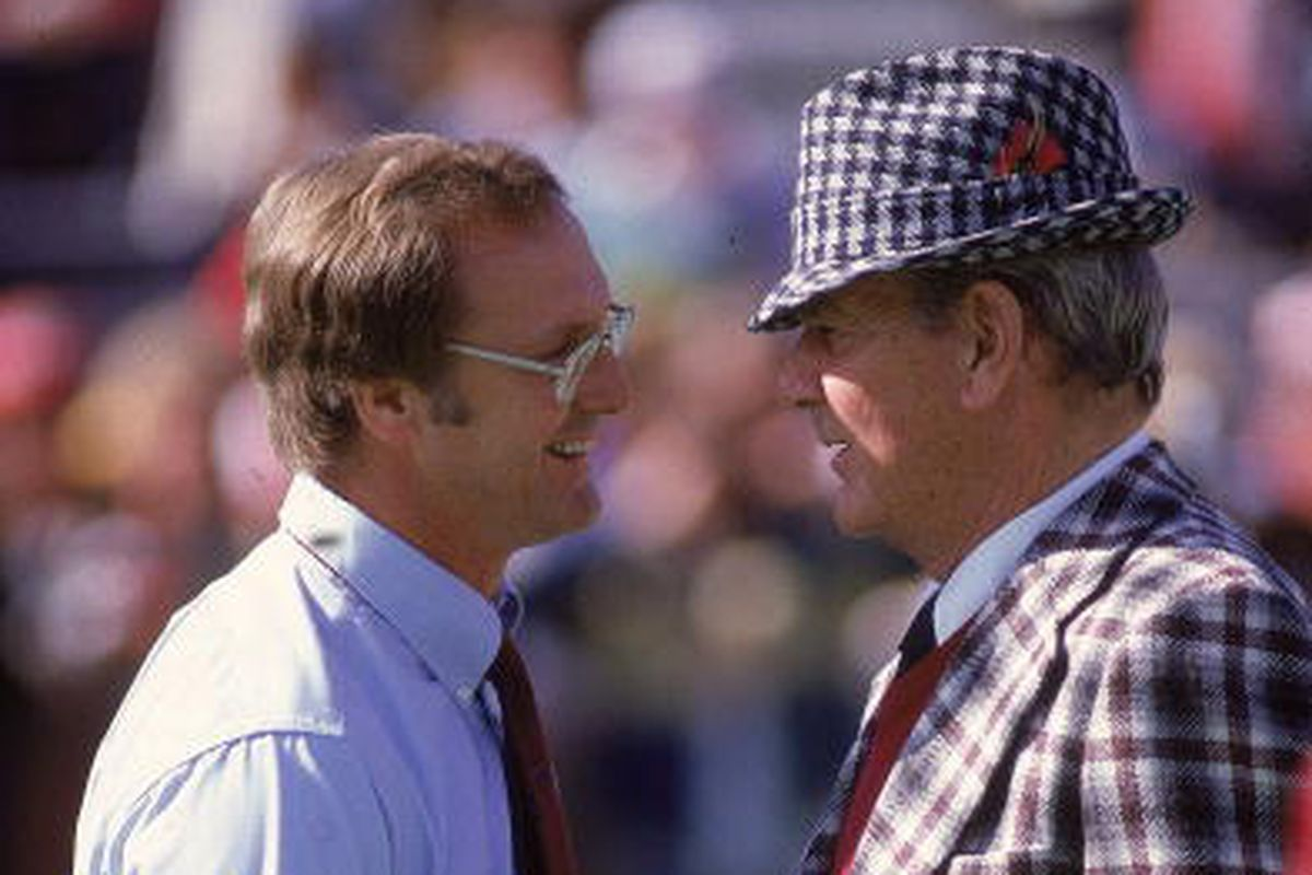 Alabama coach Paul Bear Bryant (L) shaking hands with Louisiana State coach Jerry Stovall (R) before game, Birmingham, AL 11/6/1982