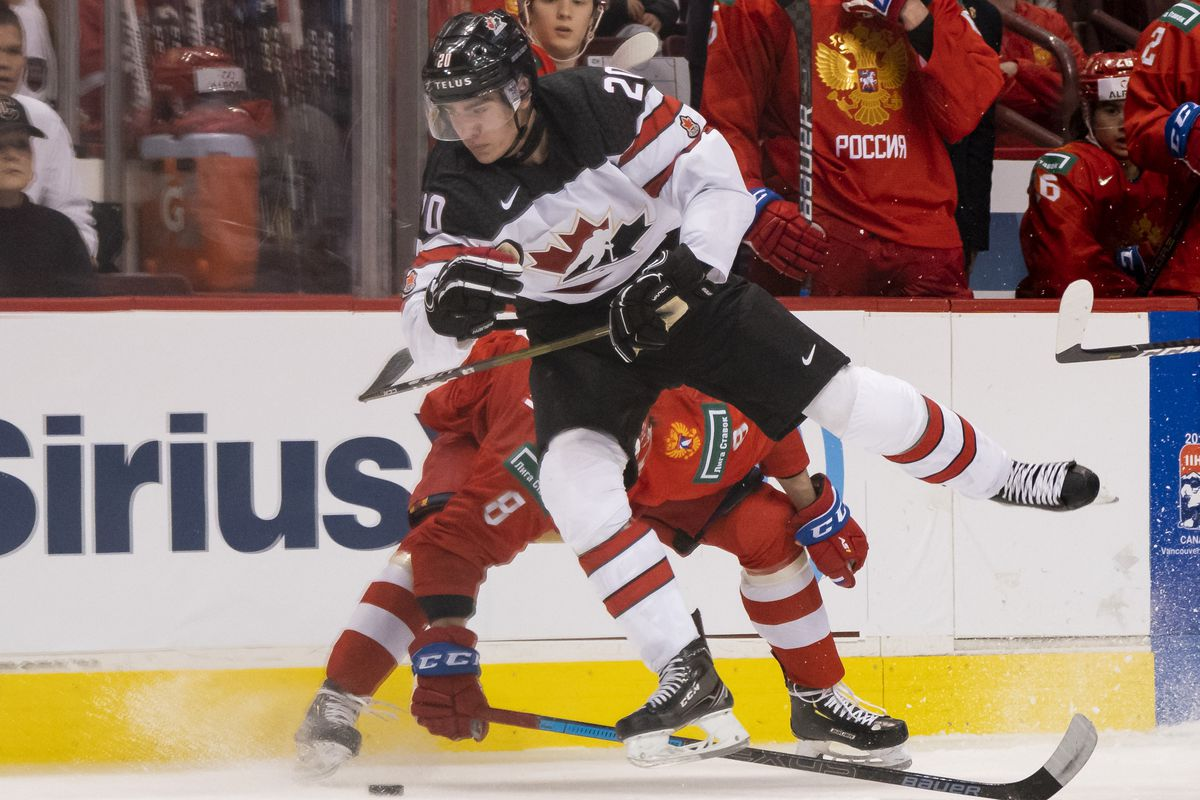 VANCOUVER, BC - DECEMBER 31: Brett Leason #20 of Canada tries to sidestep a bodycheck from Saveli Olshanski #8 of Russia in Group A hockey action of the 2019 IIHF World Junior Championship on December, 31, 2018 at Rogers Arena in Vancouver, British Columb