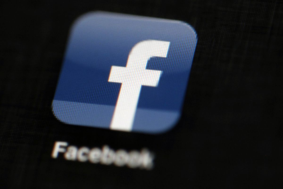 FILE - In this May 16, 2012, file photo, the Facebook logo is displayed on an iPad in Philadelphia. Intelligence officials warn that foreign adversaries continue to wage cyber warfare against the U.S. election systems. But with the midterm elections just
