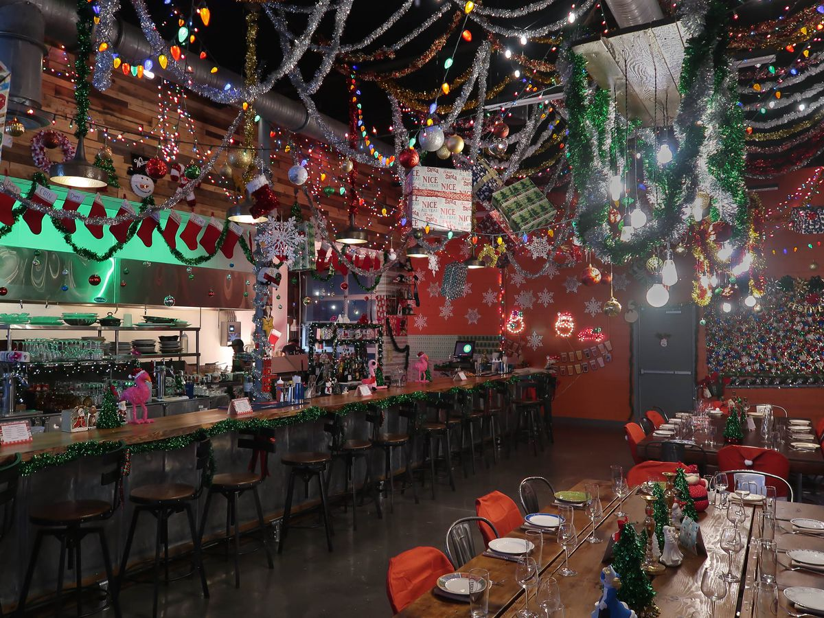 The kitchen bar  and restaurant with tinsel, stockings, Christmas trees, and santas during Mingle and Jingle pop-up at Best End Brewing, West End, Atlanta in December 2019