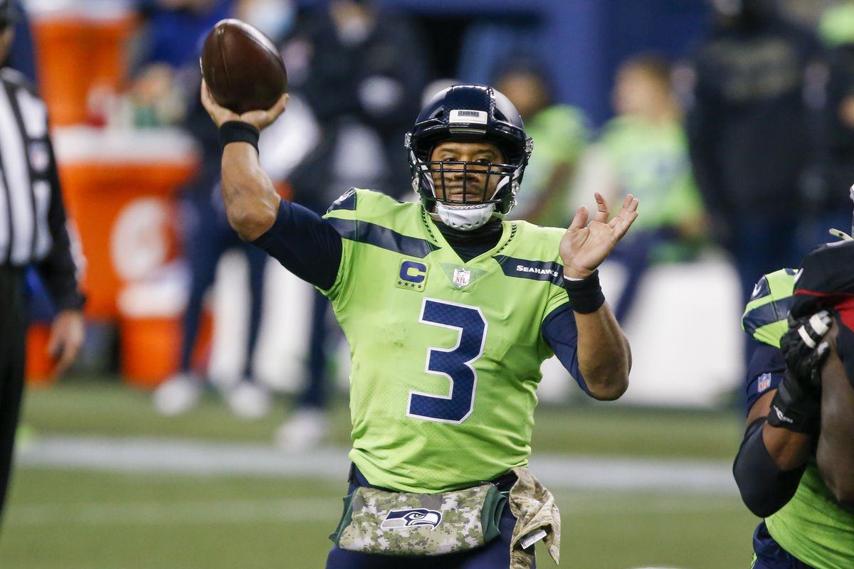 Seattle Seahawks quarterback Russell Wilson throws a touchdown pass against the Arizona Cardinals during the second quarter at Lumen Field.