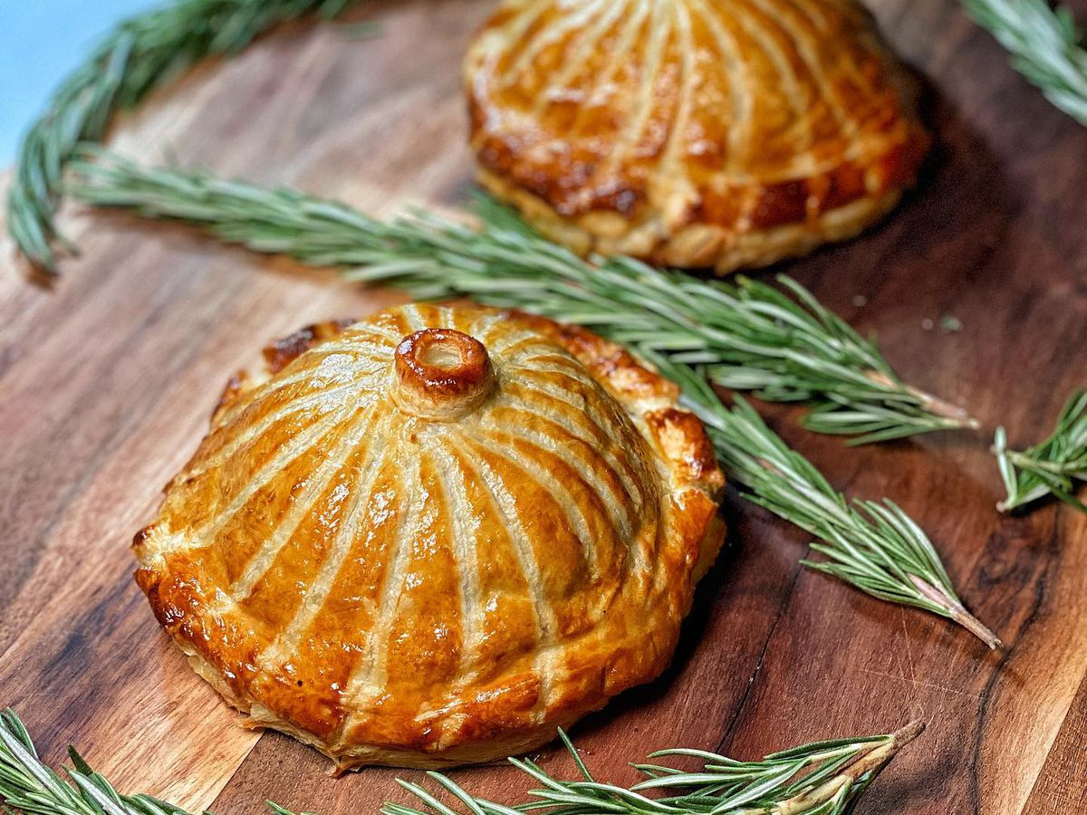 Duck pithivier baked in puff pastry dough, stuffed with buttered cabbage, and seared foie gras.