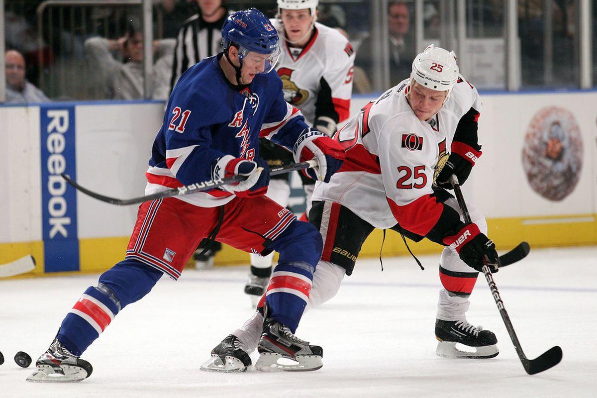 NEW YORK, NY - JANUARY 12: Derek Stepan #21 of the New York Rangers skates alongside Chris Neil #25 of the Ottawa Senators at Madison Square Garden on January 12, 2012 in New York City.  (Photo by Nick Laham/Getty Images)