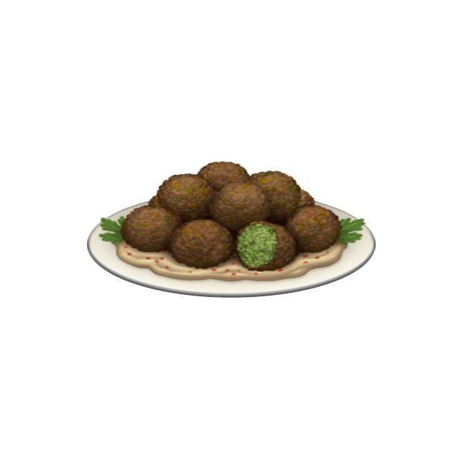 multiple falafel on a plate of hummus