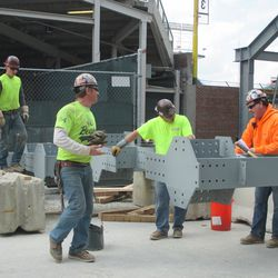 2:19 p.m. The framework for the right field video board being assembled on Sheffield -