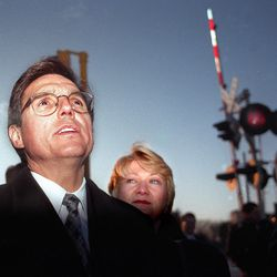 Secretary of Transportation Federico Pena and Jolene Molitoris, administrator for the Federal Railroad Administration examine the railroad crossing in Fox River Grove where 7 students from Cary-Grove High School died when a Metra train collided with a school bus in October 1995.