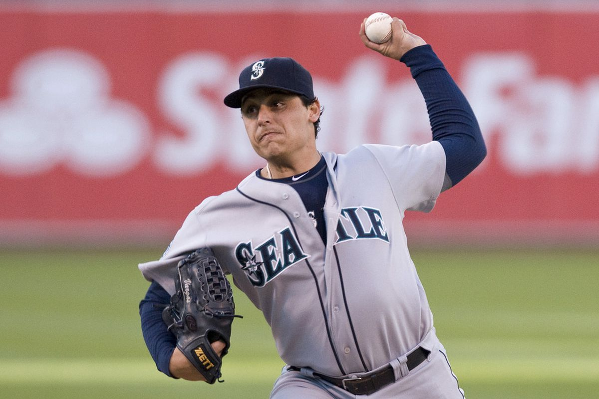 July 7, 2012; Oakland, CA, USA; Seattle Mariners starting pitcher Jason Vargas (38) throws a pitch to a Oakland Athletics batter during the first inning at O.co Coliseum.  Mandatory Credit: Ed Szczepanski-US PRESSWIRE