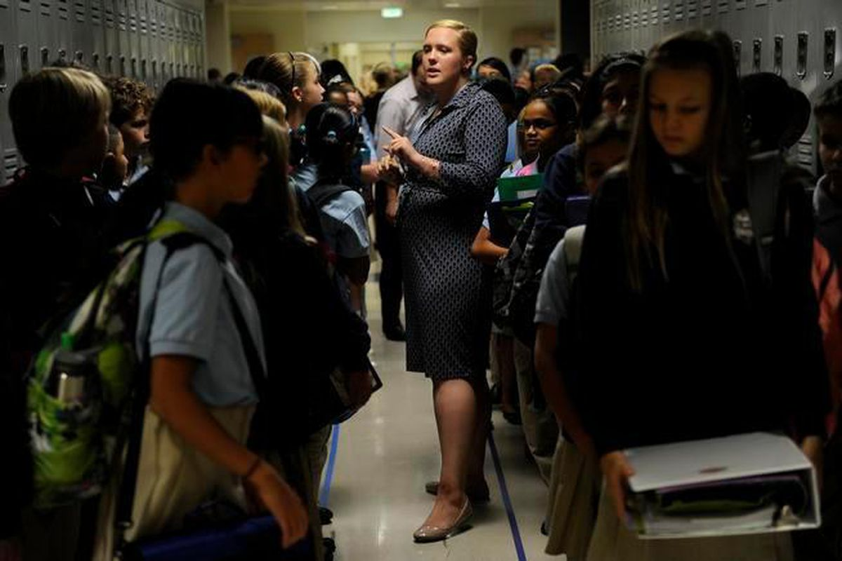 Katie Ethridge talks to her sixth grade science class in the hallway at DSST's Byers campus in 2014. The building reopened after $19 million in renovations paid for through Denver's 2012 bond (Denver Post file).
