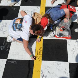 Fans write a message to their favorite drivers before the NASCAR Sprint Cup Series auto race Sunday, April 1, 2012, in Martinsville, Va.