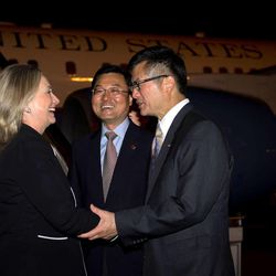 U.S. Secretary of State Hillary Rodham Clinton, left, shakes hands with U.S. Ambassador to China Gary Locke, center,  and Director General for North American and Oceanian Affairs Xie Feng, second left,  upon her arrival at Beijing Capital International Airport in Beijing, China, Tuesday, Sept. 4, 2012.