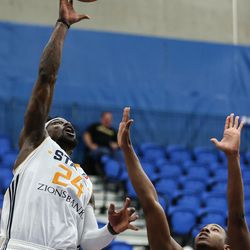 Salt Lake City Stars guard Jermaine Taylor (24) shoots over Los Angeles D-Fenders guard Kenneth Smith (2) at the Lifetime Activities Center in Taylorsville on Wednesday, Feb. 08, 2017.