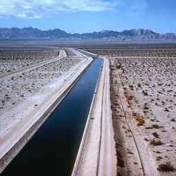 """FILE - In this undated file photo, water flows through the Southern California desert in the Metropolitan Water District's Colorado River Aqueduct from the Colorado River to the Los Angeles area. A pricing dispute has sharply escalated hostilities between San Diego and the agency that delivers water to much of Southern California, straining an odd partnership already defined by years of lawsuits and heated rhetoric. The San Diego County Water Authority launched a website to attack the MWD, its largest supplier, saying it wanted to lift a veil of secrecy. The site displays a trove of internal documents obtained under California's public records law, including references to a """"Secret Society"""" and an """"anti-San Diego coalition."""""""