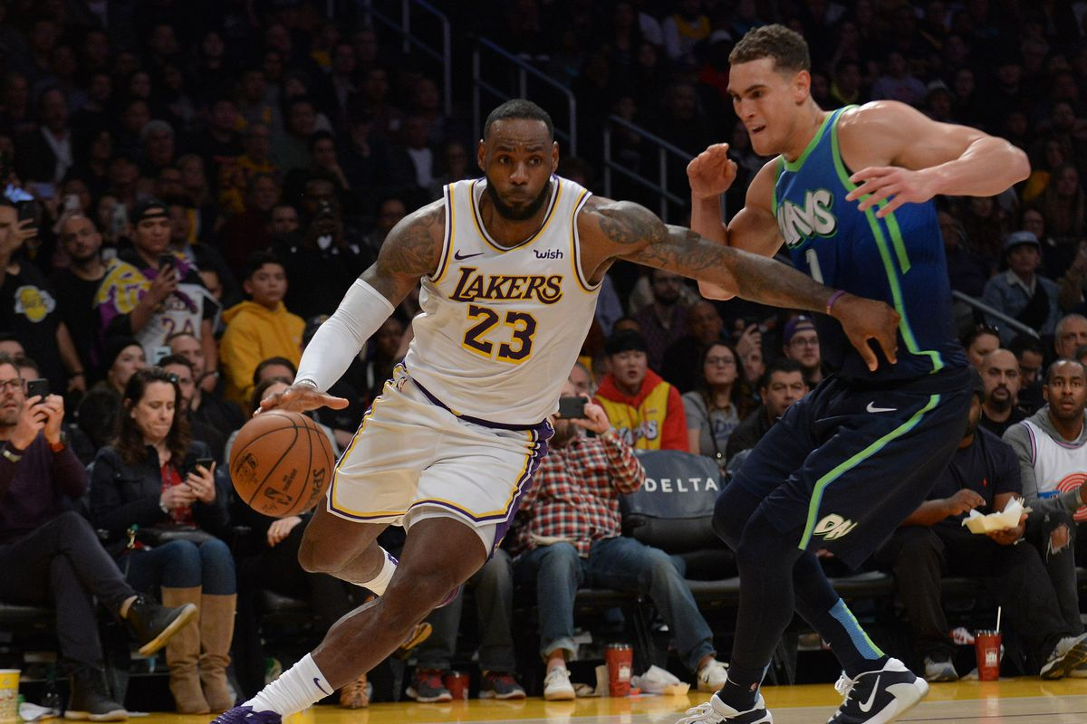 Los Angeles Lakers forward LeBron James moves the ball against Dallas Mavericks forward Dwight Powell during the second half at Staples Center.