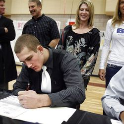 Chase Hansen signs his letter of intent at Lone Peak High School on Wednesday, February 1, 2012.  Hansen will be playing football at the University of Utah.
