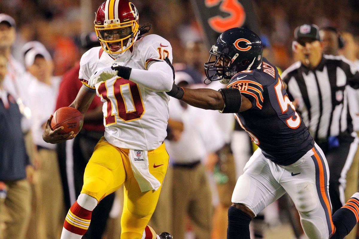 Aug 18, 2012; Chicago, IL, USA; Washington Redskins quarterback Robert Griffin III (10) is pursued by Chicago Bears linebacker Nick Roach (53) during the second quarter at Soldier Field. Mandatory Credit: Dennis Wierzbicki-US PRESSWIRE