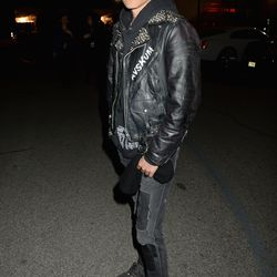 Jared Leto wears a leather jacket and skinny jeans.