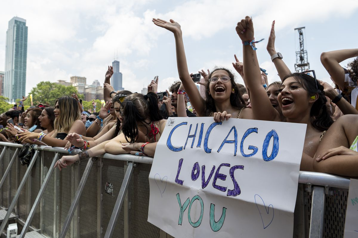 Fans cheer and wave as Aly & AJ preform at the T-Mobile stage at Lollapalooza, Thursday, July 29, 2021.