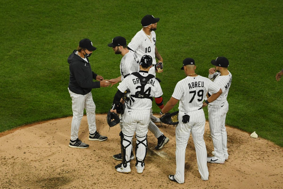 Lucas Giolito hands the ball to White Sox manager Tony La Russa after being taken out of the game ion the seventh inning.