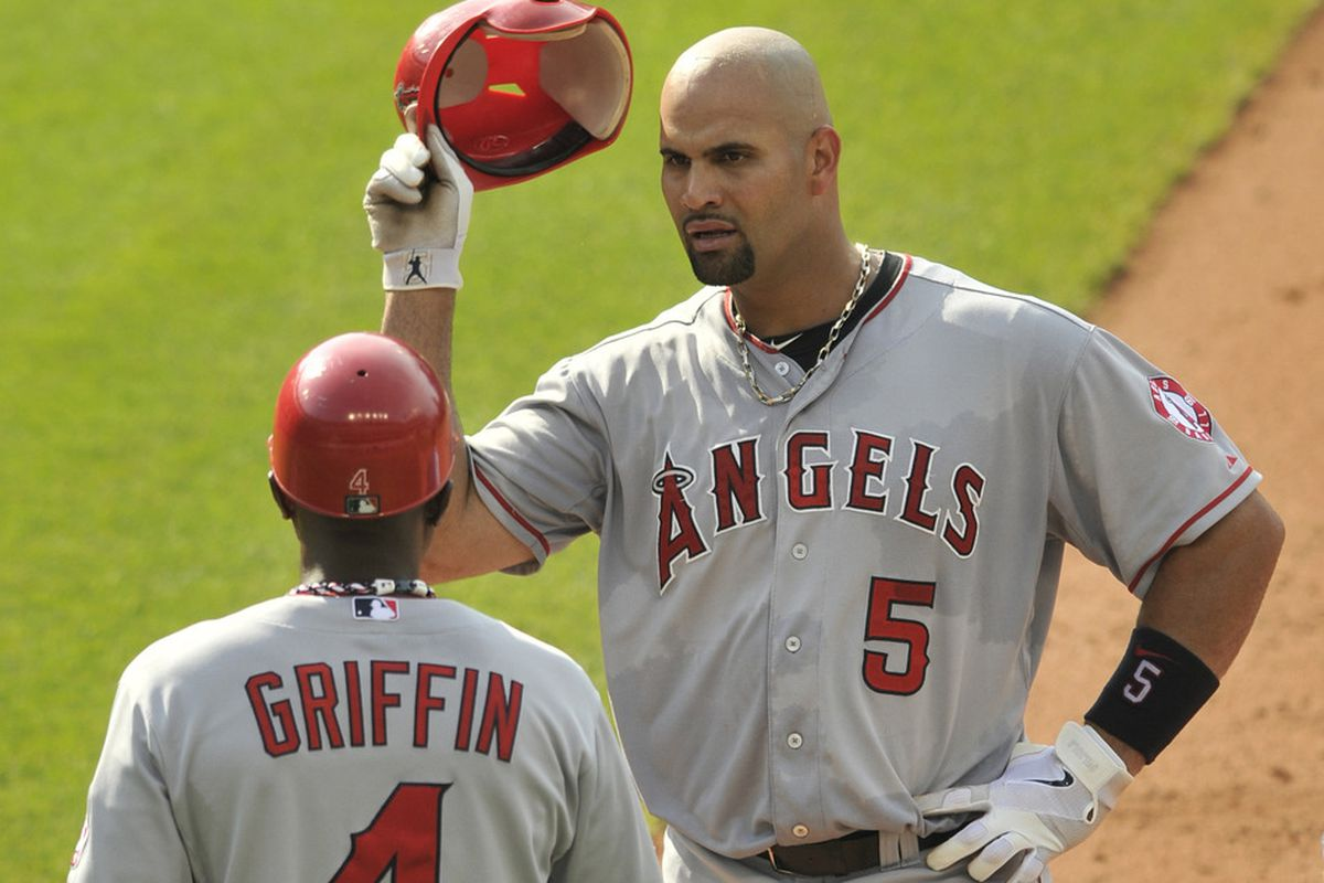 Jul 4, 2012; Cleveland, OH, USA; Los Angeles Angels first baseman Albert Pujols (5) takes off his helmet after flying out in the fifth inning against the Cleveland Indians at Progressive Field. Mandatory Credit: David Richard-US PRESSWIRE